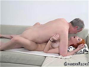 Ginger nubile penetrates gramps