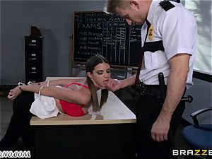 Policeman penalizes mischievous student on the table
